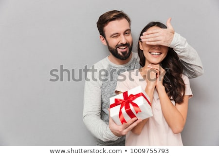 lovely young couple hugging while standing stock photo © deandrobot