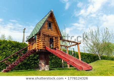 treehouse with slide playground Stock photo © bluering