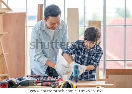 Szczęśliwy ojciec mały syn warsztaty rodziny Zdjęcia stock © dolgachov