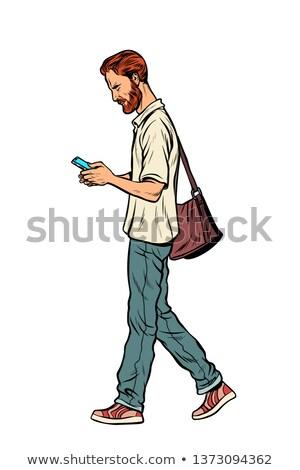 бородатый мужчины пешеход мобильного телефона современных Сток-фото © studiostoks