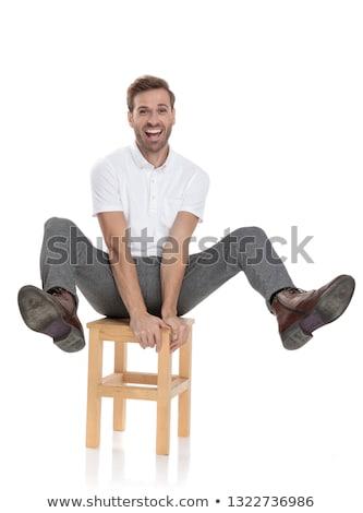 Férfi ül lábak levegő vicces játékos Stock fotó © feedough