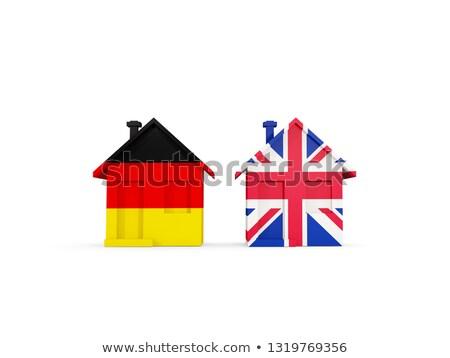 Zwei Häuser Fahnen Deutschland Vereinigtes Königreich isoliert Stock foto © MikhailMishchenko