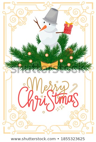snowman with bucket on head on spruce branches stock photo © robuart