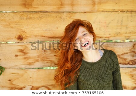 Woman tossing her hair in the outdoors Stock photo © lovleah