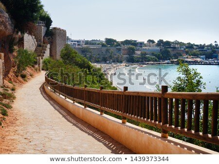 Empty fenced walkway leading to the Cabo Roig beach full of tour Stock photo © amok
