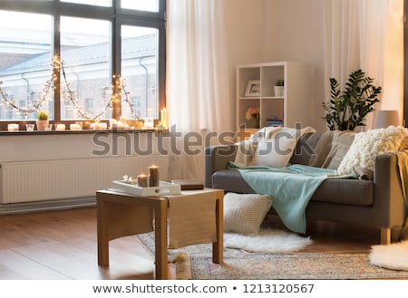 candles burning on window sill with garland lights Stock photo © dolgachov