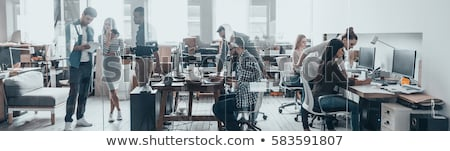 Young professional working on laptop standing Stock photo © nyul