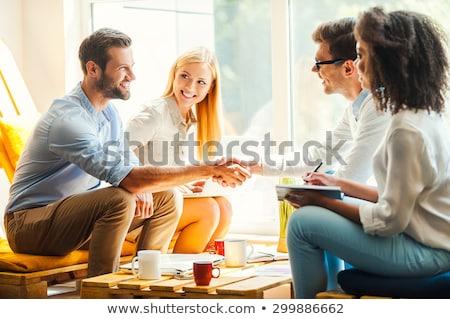 бизнес-команды два деловые люди рукопожатием сидят рабочих Сток-фото © Freedomz