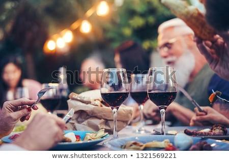 Happy man having red wine in restaurant Stock photo © wavebreak_media