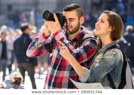 Man Taking Photograph Of Couple Walking Together At Outdoors Stock photo © AndreyPopov