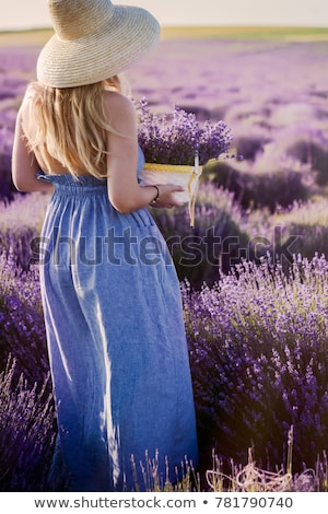 Beautiful woman in straw hat in violet lavender field  Stock photo © dashapetrenko