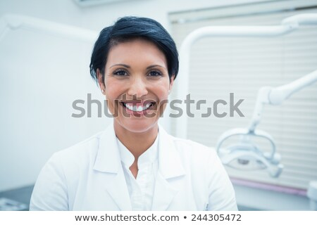 Frente vista maduro femenino dentista examinar Foto stock © wavebreak_media