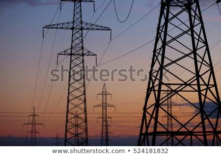 Metal alta tensão poder linha pôr do sol nascer do sol Foto stock © ruslanshramko