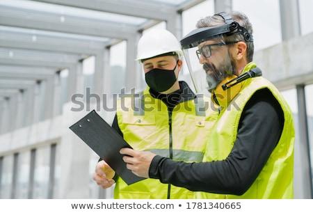 Amarillo alto visibilidad chaleco casco mesa Foto stock © papa1266