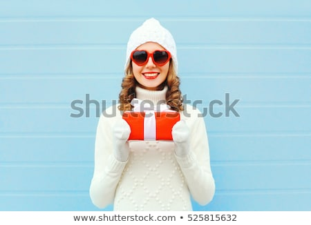 girl in christmas cap and glasses with gift boxes stock photo © massonforstock