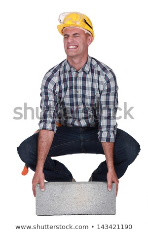 Builder struggling to lift Stock photo © photography33