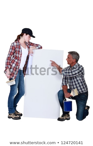 Tradespeople looking at a blank sign Stock photo © photography33