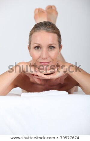 blond woman laid on massage table stock photo © photography33
