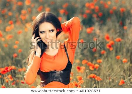 Portrait of a dreamy brunette in a corset Stock photo © acidgrey