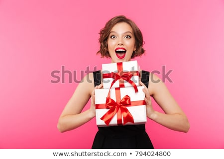 young christmas girl dressed in red stock photo © carlodapino