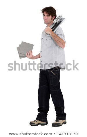 tiler holding tiles in studio background Stock photo © photography33