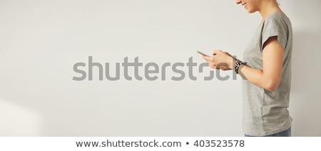 jonge · vrouwelijke · typen · witte · gezicht - stockfoto © wavebreak_media