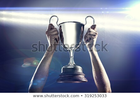 holding a trophy and smiling stock photo © feedough