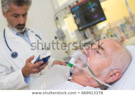 Patient with oxygen mask in hospital ward stock photo © wavebreak_media