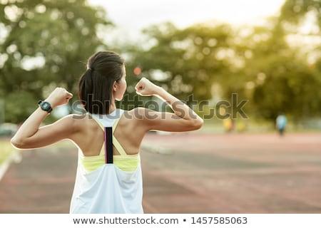 sportos · nő · mutat · bicepsz · fitnessz · tornaterem - stock fotó © dash