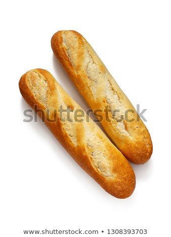 Closeup of two fresh petit pain with a bread knife Stock photo © sarahdoow