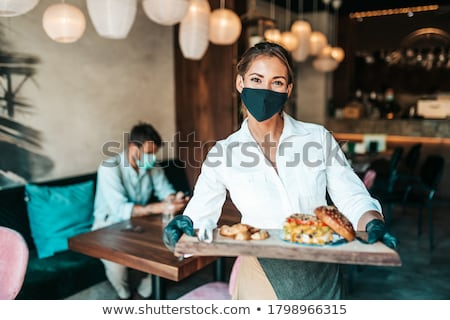 waitress serving in american diner or restaurant stock photo © kzenon