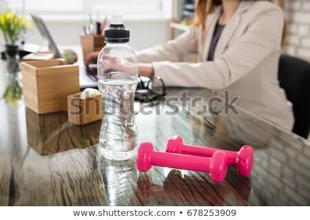 Dumbbell on desk Stock photo © IMaster