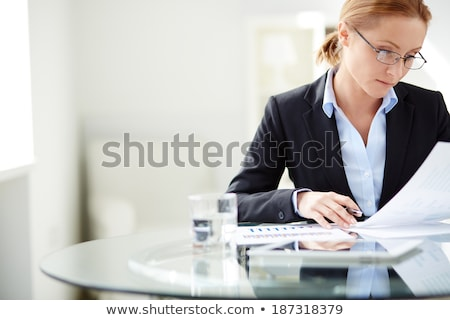 young successful businesswoman reading a document stock photo © jeliva