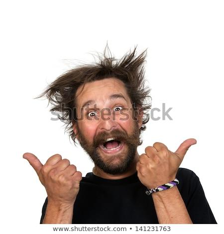 Jovem casual cara dobrar Foto stock © stockyimages