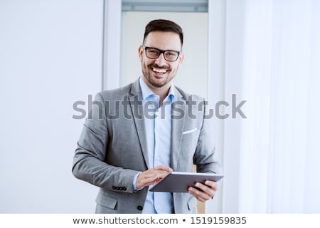 confident Caucasian businessman standing looking at camera stock photo © dgilder