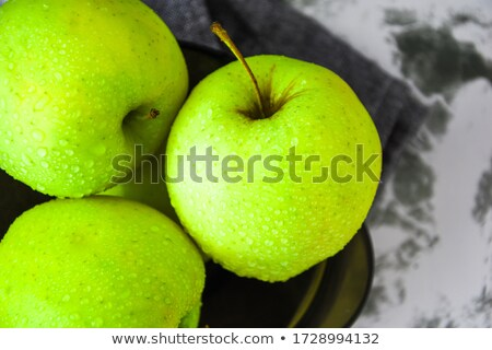 Granny smith and golden apples for sale in a supermarket Stock photo © bmonteny