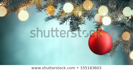 Stock photo: red christmas ball hanging on a branch