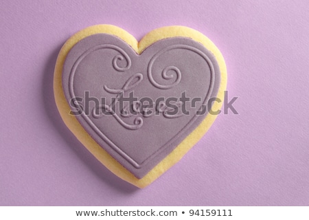close up of an iced heart shaped biscuit for valentines day stock photo © sarahdoow