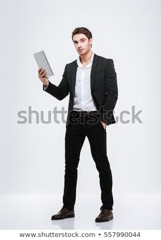 boldog · üzletember · öltöny · tart · táblagép · üzletemberek - stock fotó © deandrobot