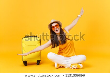 happy woman in airport stock photo © ssuaphoto
