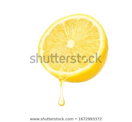 lemon juice isolated on white Stock photo © ozaiachin