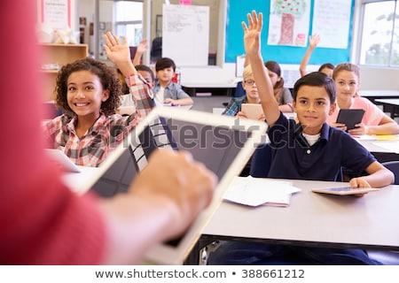 teacher and pupils looking at tablet computer stock photo © wavebreak_media