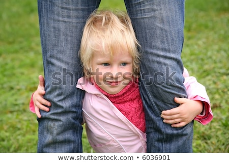 daughter stands and he is held for the feet in jeans Stock photo © Paha_L