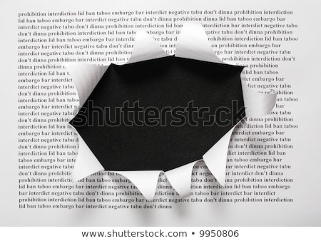 Сток-фото: Sheet Of Paper With Printing Text And Cut Hole Against Black Background