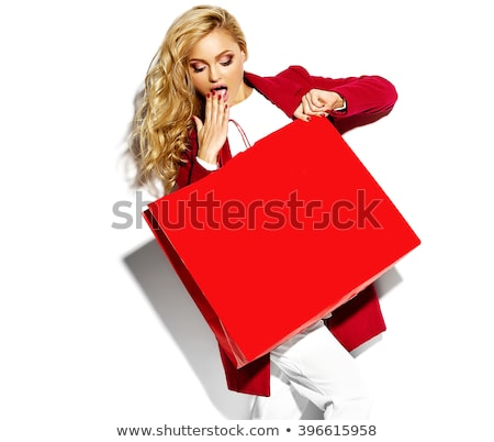 Funny blond woman with shopping bags Stock photo © Aikon