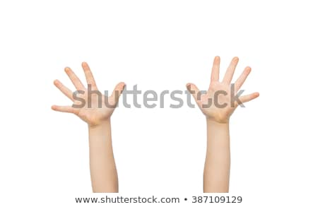 close up of little child hands raised upwards Stock photo © dolgachov