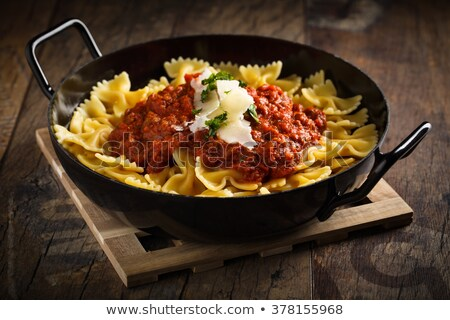 Pasta farfalle with tomato sauce and cheese stock photo © Digifoodstock