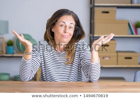Verward zakenvrouw schouders kaukasisch twijfelachtig Stockfoto © RAStudio