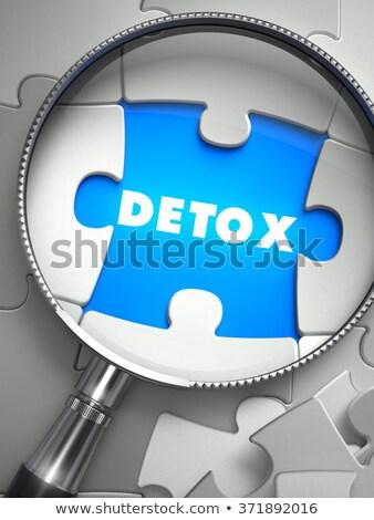 Detox - Puzzle with Missing Piece through Loupe. Stock photo © tashatuvango