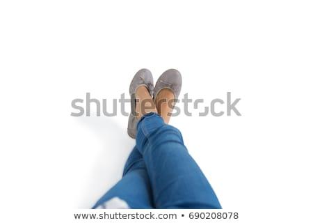 Mulher as pernas cruzadas tornozelo branco telefone feminino Foto stock © wavebreak_media